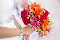 Bride with bouquet of flowers and roses Royalty Free Stock Photo