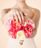 Bride with bouquet of flowers and wedding ring Stock Photos