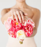 Bride with bouquet of flowers and wedding ring Stock Image
