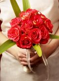 Bride with bouquet in front Stock Photo