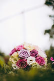 Bride bouquet in the grass. With nicely blurred background stock photos