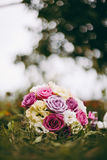 Bride bouquet in the grass. With nicely blurred background royalty free stock photos