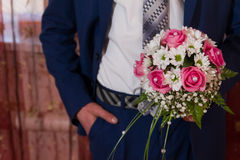 The bride with a bouquet. The groom in a suit and with a bouquet Royalty Free Stock Images