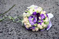 Bride bouquet on the ground Royalty Free Stock Images
