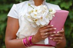 Bride with bouquet and handbag, closeup Royalty Free Stock Photo