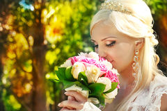 Bride with bouquet in the hands Royalty Free Stock Image