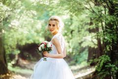 Bride with a bouquet in her hand with a shallow depth of field stock photography