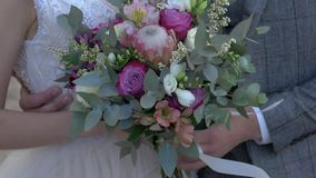 Bride with bouquet in hands stock video footage