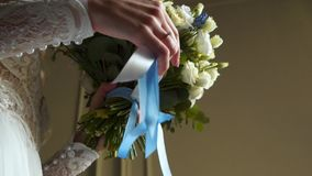 Bride with bouquet. Bride holding bouquet with ribbons stock video footage
