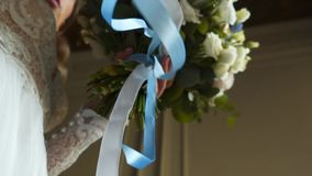 Bride with bouquet. Bride holding bouquet with ribbons stock video
