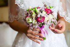 Bride Bouquet. Bride holding a bouquet of roses Stock Photography