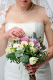 Bride with a bouquet. Bride holds a wedding bouquet Stock Photos