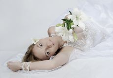 Bride with a bouquet of lilies Royalty Free Stock Images