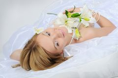 Bride with a bouquet of lilies Royalty Free Stock Photography
