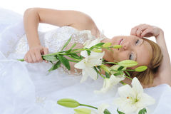 Bride with a bouquet of lilies Stock Photo