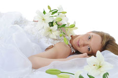 Bride with a bouquet of lilies Royalty Free Stock Image