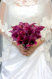 Bride and bouquet of lilies Stock Photos