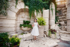 Bride with a bouquet near the ancient architecture with columns Stock Photography