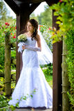 Bride with bouquet outdoors Stock Image