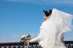 Bride with bouquet at parapet Royalty Free Stock Photo