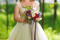 Bride with Bouquet in Park Royalty Free Stock Photo