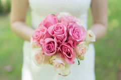 Bride with bouquet of pink and white roses. Stock Photography