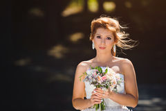 Bride with Bouquet. Portrait of beautiful bride with wedding bouquet Royalty Free Stock Photos