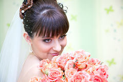 Bride with bouquet of red roses. Young beautiful bride with bouquet of red roses stock image