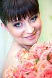 Bride with bouquet of red roses. Young beautiful bride with bouquet of red roses royalty free stock photo