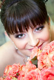 Bride with bouquet of red roses. Young beautiful bride with bouquet of red roses stock photos