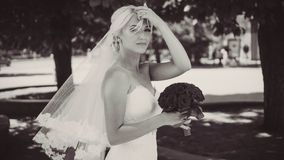 Bride with a bouquet of red roses. Black and white photo royalty free stock photos