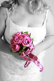 Bride with bouquet of roses Stock Photography
