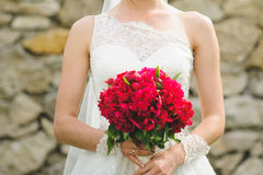 Bride with Bouquet at Stone Wall Stock Photo