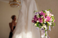 Bride, bouquet and wedding dress Stock Photos