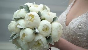 Bride with bouquet of peonies. Bride with bouquet of white peonies stock video footage