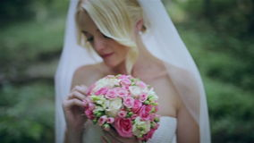 The bride with a bouquet in the wood. HD stock footage