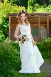 Bride with a bouquet and wreath Royalty Free Stock Photography