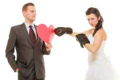 Bride boxing her groom on wedding Stock Photos