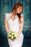 Bride with braids and flower bouquet Stock Photo