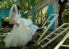 Bride breaking window Royalty Free Stock Images