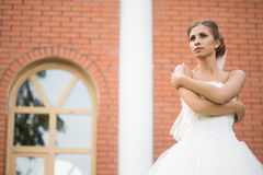 Bride on a brick wall background. wedding Dress Royalty Free Stock Image