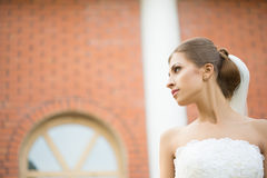Bride on a brick wall background. wedding Dress Royalty Free Stock Images