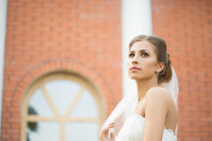 Bride on a brick wall background. wedding Dress Royalty Free Stock Photography