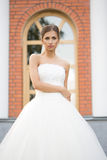 Bride on a brick wall background. wedding Dress Royalty Free Stock Photos