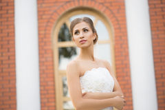 Bride on a brick wall background. wedding Dress Royalty Free Stock Photo