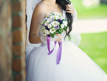 Bride at Brick Wall Royalty Free Stock Image