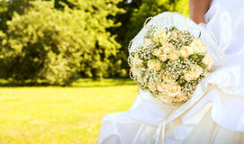 Bride with bridal bouquet. (focus on the flowers stock photos