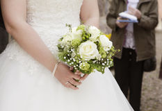 Bride with bridal bouquet in her hand Stock Image