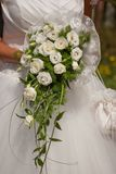 Bride with bridal bouquet of white flowers. Wedding scene with bride dress and bouquet Stock Image