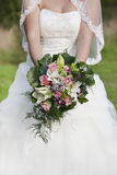 Bride with bridal bouquet Stock Image